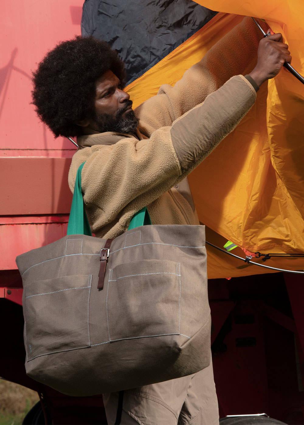 model wearing the Tim Hemp Tote in Khaki