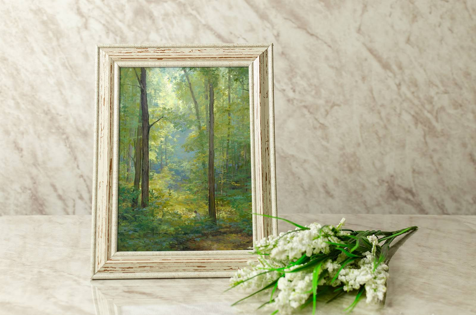 Small art of the Sacred Grove next to a bouquet of white flowers.