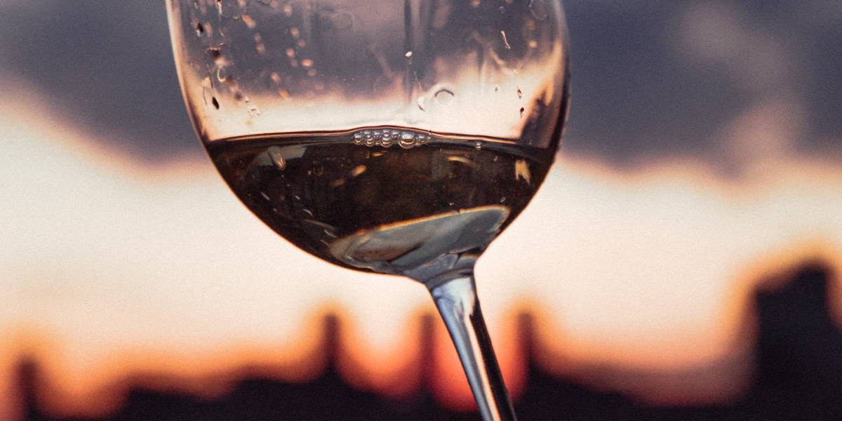 Close up of wine in the glass highlighting the definition of body referring to how full or light a wine is.