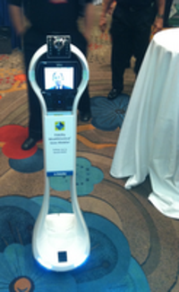 Fidelity's VGo, a four-foot-tall robot on wheels, sporting the live image of Fidelity's applied technology head, Al Lee, was one of the stars of the T3 gathering.