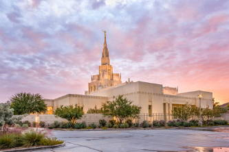 Phoenix Temple against a purple, pink, and orange sunset.