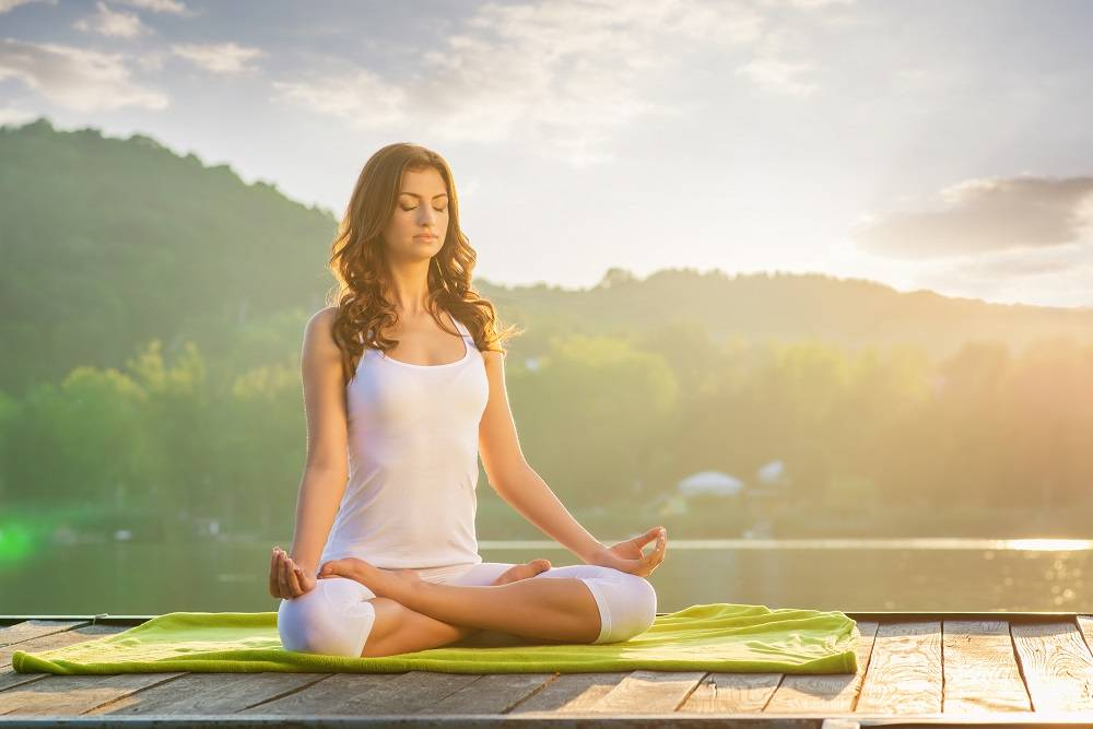 woman relaxed meditation in nature - dendera naturally