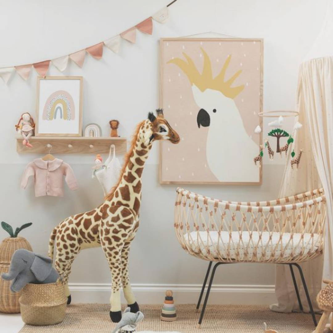 safari themed neutral nursery with crib, storage and giraffe
