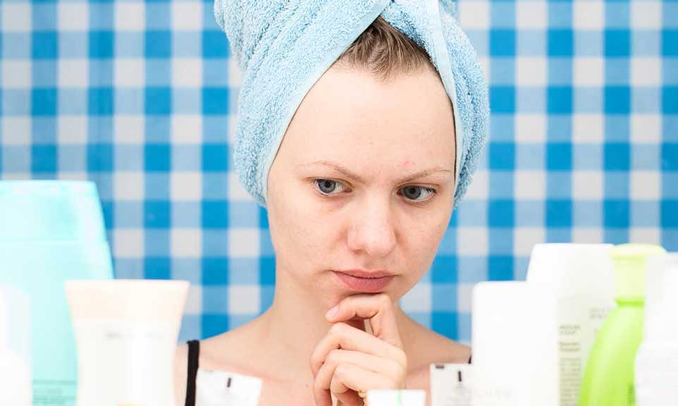 woman with wet hair wrapped up in a towel
