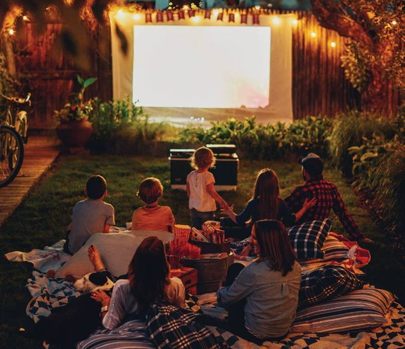 family watching a movie with a mini LED Projector