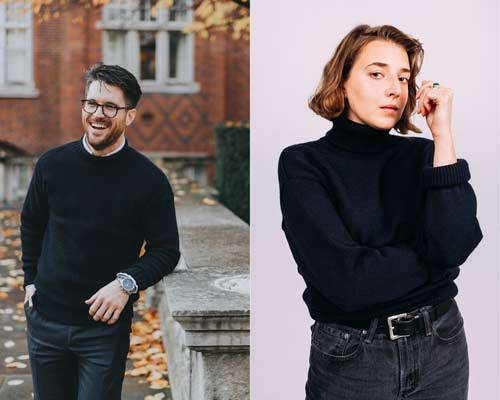 Man smiling wearing navy fisherman guernsey knit jumper with dark trousers and woman wearing navy submariner turtleneck jumper and charcoal jeans from sustainable knitwear brand Beacon and Armour