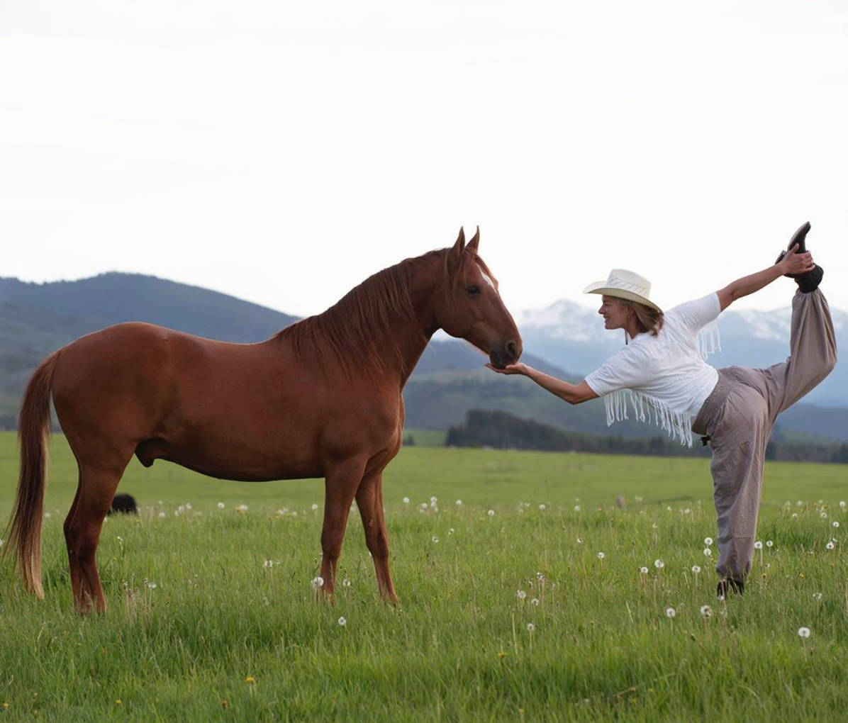 Cowgirls vs. Cancer founder doing yoga in Montana field with her horse