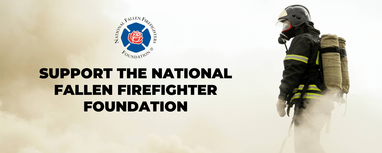 Fire fighter fighting a fire in uniform