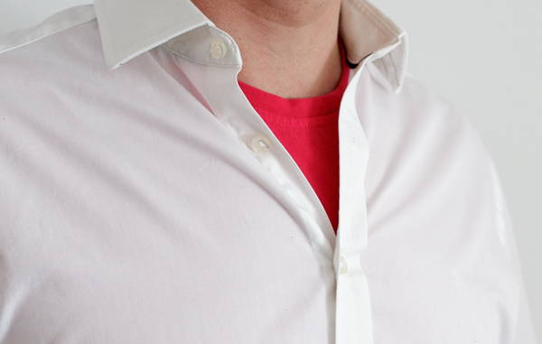 Picture of bright pink T-shirt under a white shirt