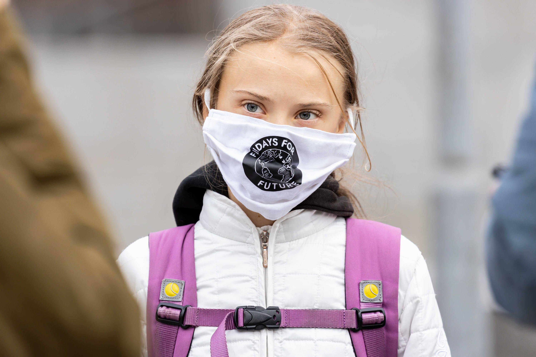 Greta Thunberg wearing a mask