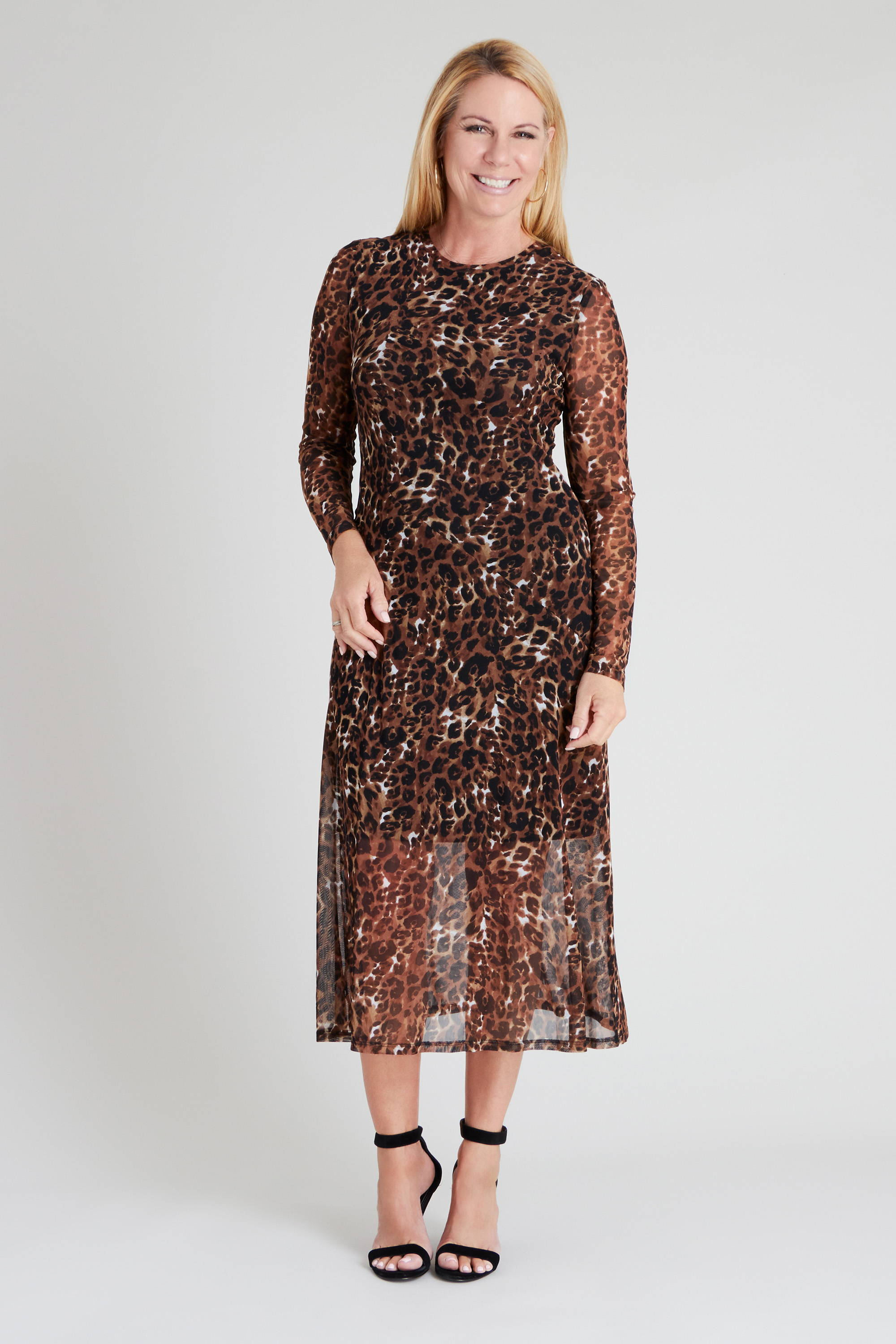 blonde woman wearing neutral cheetah print connected apparel long sleeve mesh dress