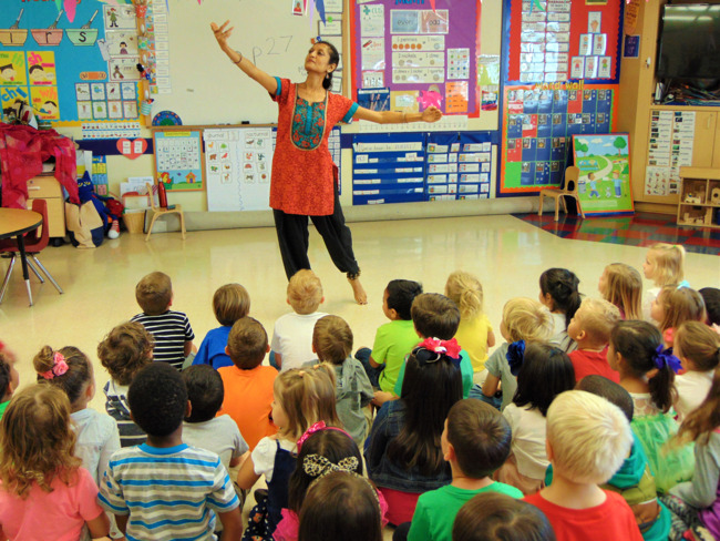 Ms. Anu performs for the toddler students of Primrose at Shady Hollow