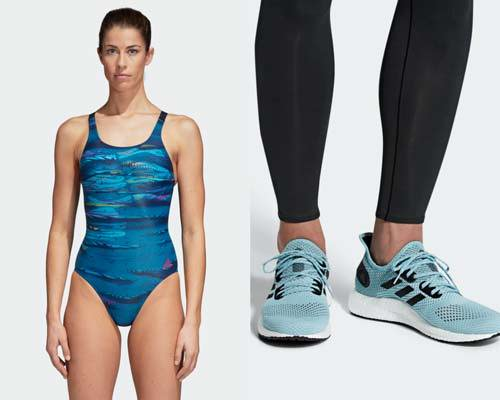 Woman wearing blue water patterned swimsuit made from recycled fishing nets and plastic from sustainable sportswear brand Adidas Parley and Man wearing Adidas Parley pale blue Prime knit running trainers