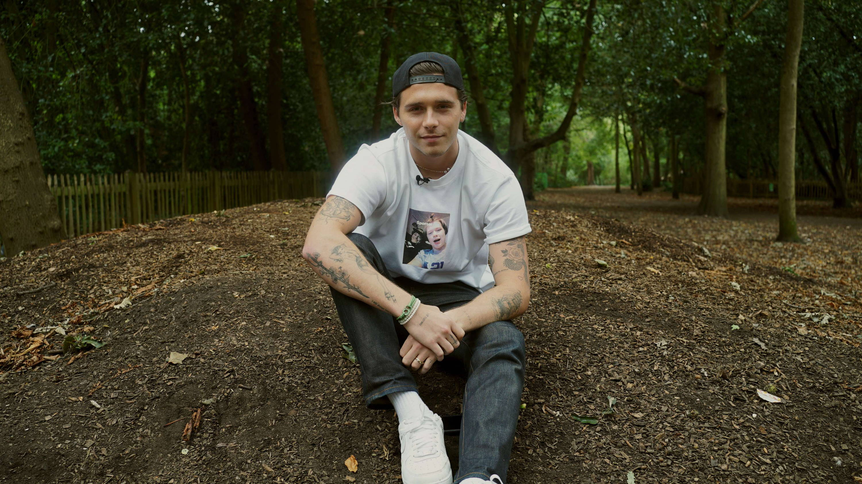 Brooklyn Beckham wears a Goal 13: Climate Action #TOGETHERBAND