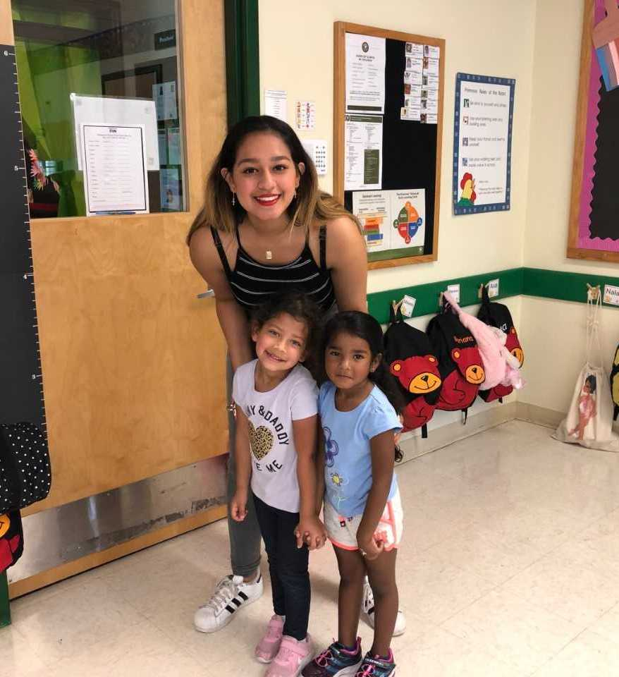 Photo of Alyssa with two little girls