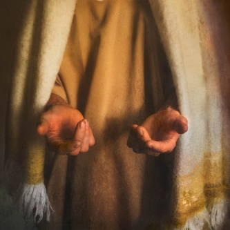 Jesus extending His scarred hands out toward the viewer.