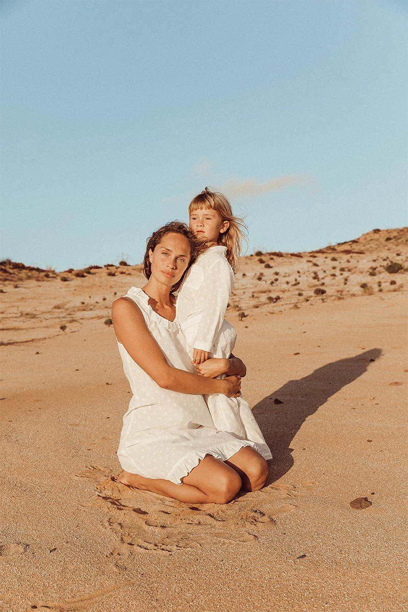 Mother and Daughter matching in cotton pyjamas on the beach