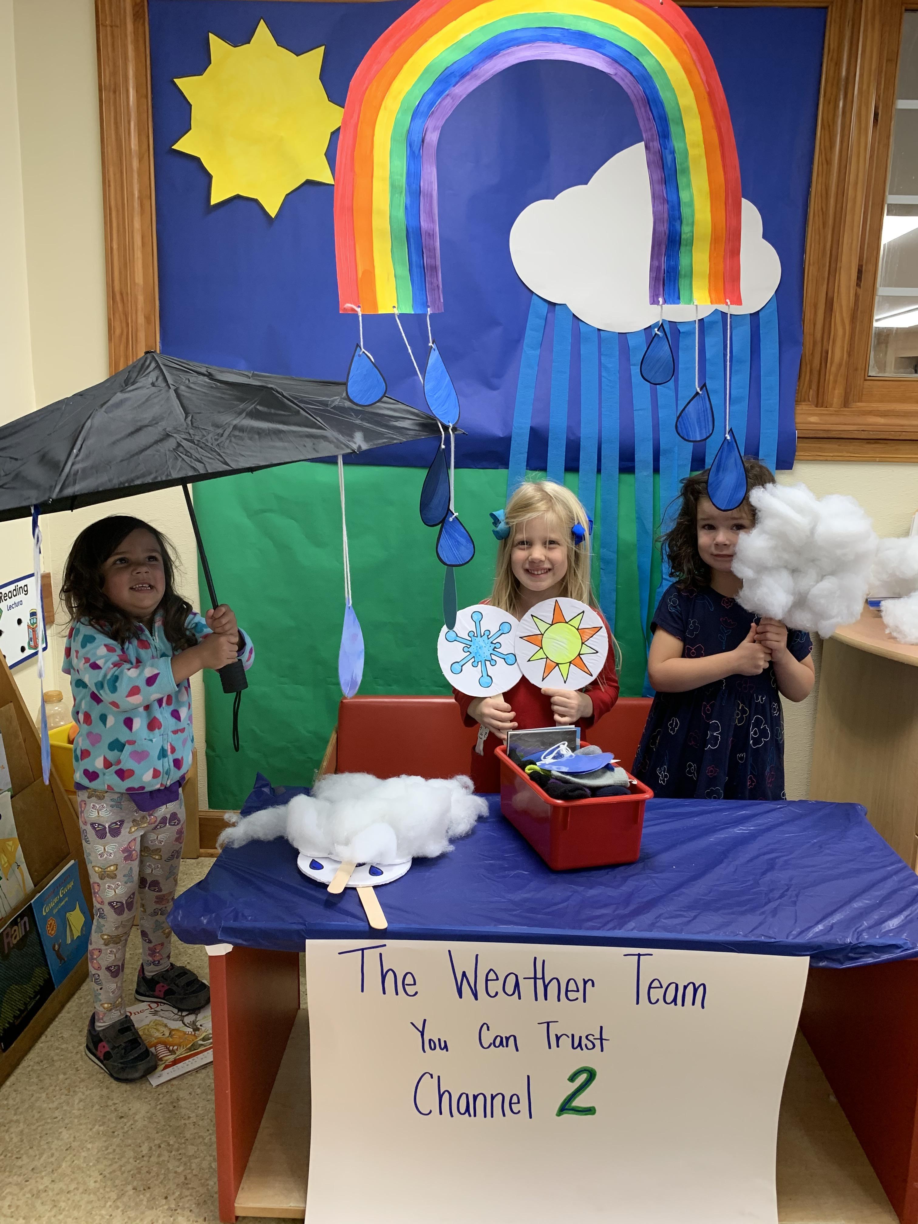 Little Girls holding umbrellas