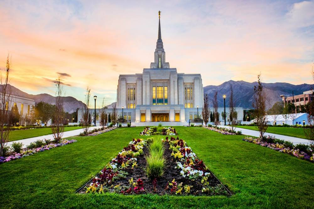 Stretch of green grass and flowerbeds leading to the Ogden Temple doors.