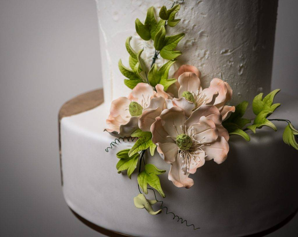Beautiful wedding cake floral details created with love by the design team at House of Clarendon in Lancaster, PA