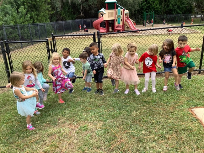 Preschoolers at Lakewood Ranch Town Center Campus built up their muscle strength by balancing on one foot.