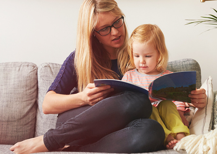 image of Child and mother reading book