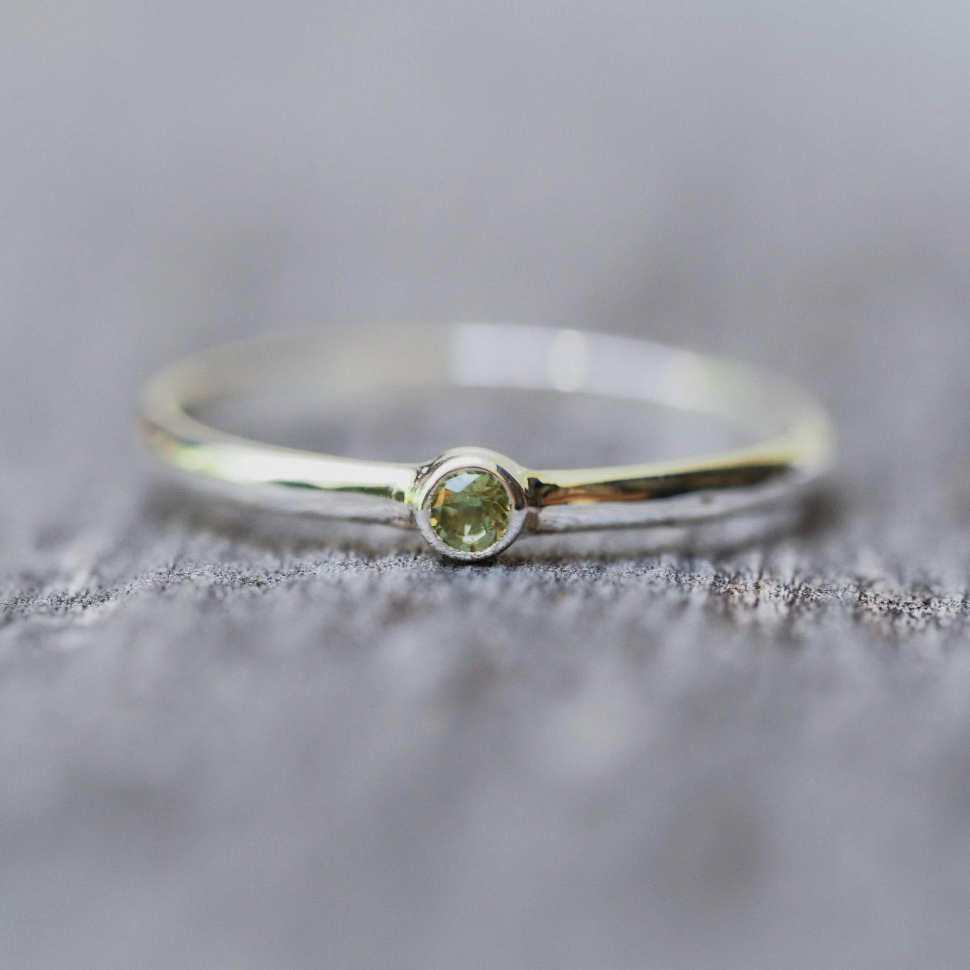 Dainty silver peridot ring.