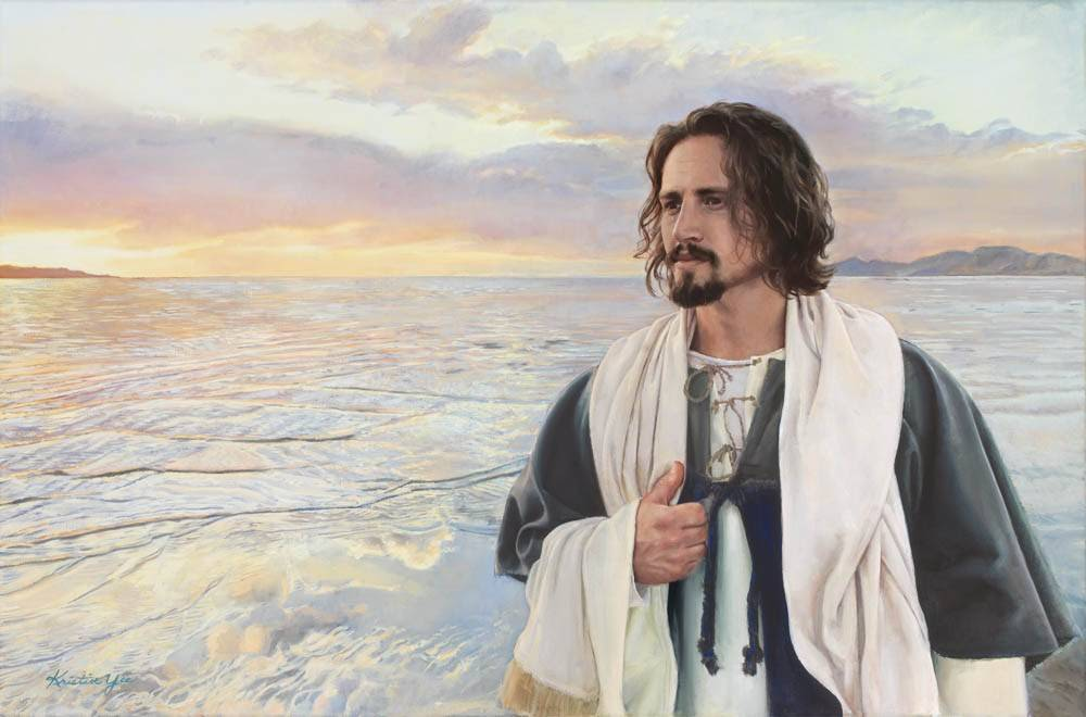 LDS art painting of Jesus walking along the seashore during a calm sunset.