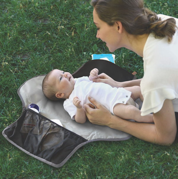 child with portable changing pad