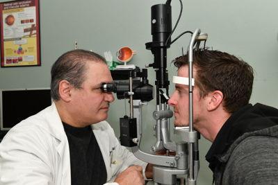 Dr. Christoforidis Examining Patient