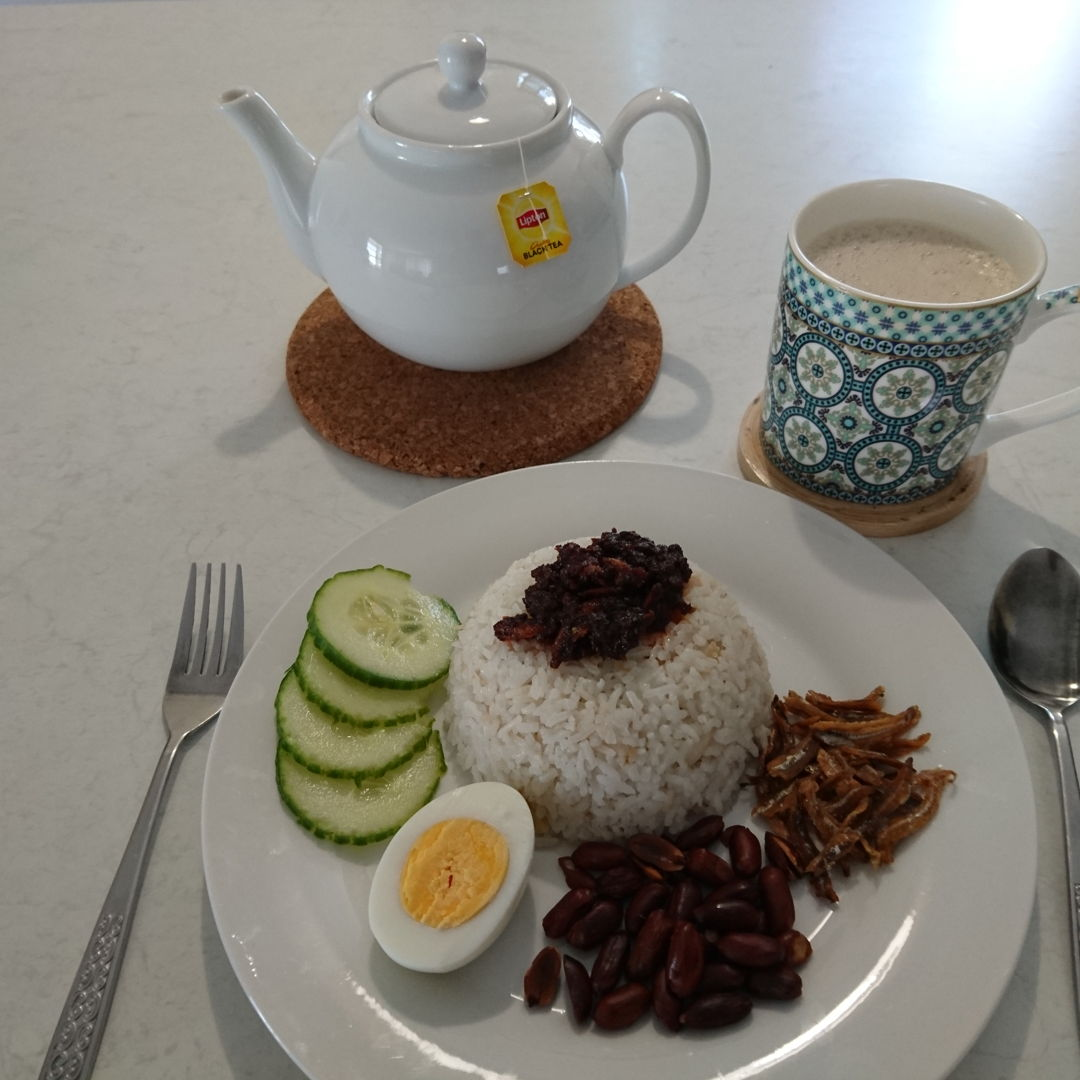 Date: 16 Oct 2019 (Wed) 4th Breakfast: Nasi Lemak (Coconut Milk Rice) [70] [Score: 8.0] Author: Nyonya Cooking [Grace Teo] Cuisine: Malaysian, Singaporean, & Bruneian Dish Type: Main  Nasi Lemak served with Sambal Nasi Lemak and TEH TARIK! I would like to dedicate all the dishes here to MasterChef Grace Teo, but it would be a disgrace for it is not up to mark yet :(. While the nasi lemak itself is excellent but the Sambal Nasi Lemak scored a poor 4.0 and the peanuts were overcooked. But, the spirit of Malaysian cooking is strong in Nyonya Cooking!  I'm beginning to feel what it is like to cook with tin coconut milk and that is good. Many of the recipes in Nyonya Cooking use tin coconut milk. Thanks to MasterChef Grace Teo for her advice last night on how to use the tin coconut milk. Also, the nasi lemak was cooked using additional spices not only in the original Nasi Lemak video, but as mentioned in the How to Wrap Nasi Lemak in Banana Leaf video.