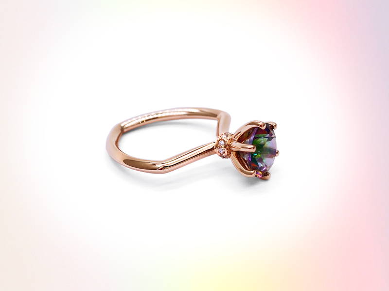 Hexagonal rose gold ring body with mystical topaz set on claws