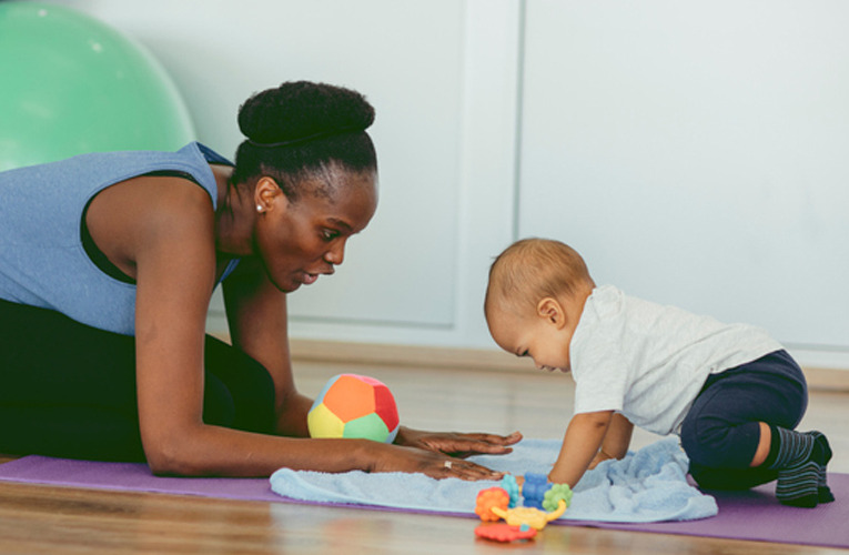 mother and baby exercising