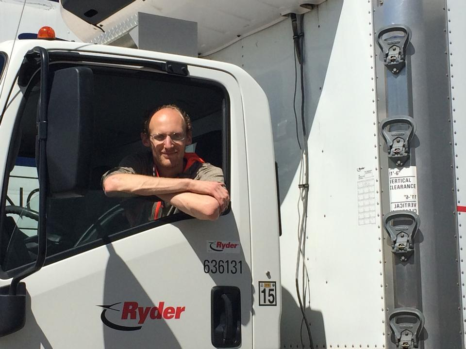 Alex Bayer picking up product, driving the delivery truck