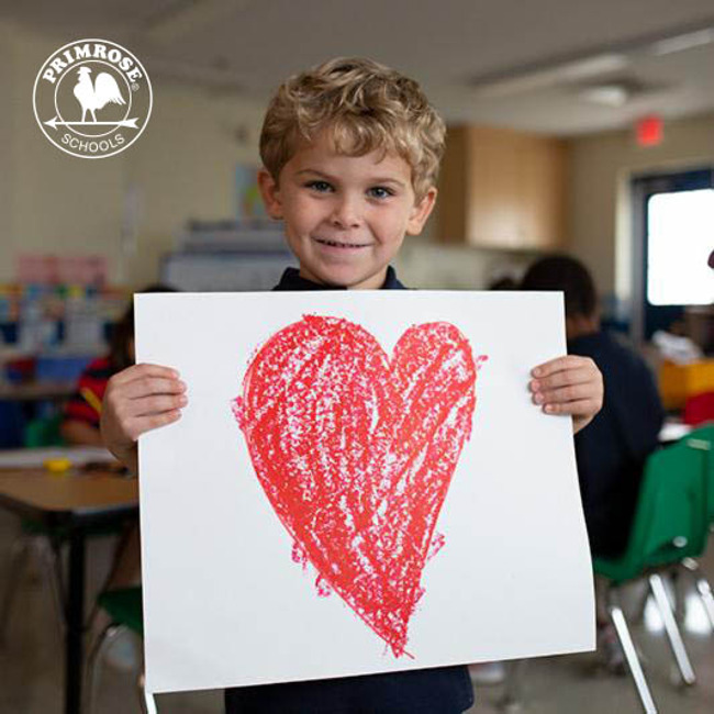 child holding banner featuring heart detail