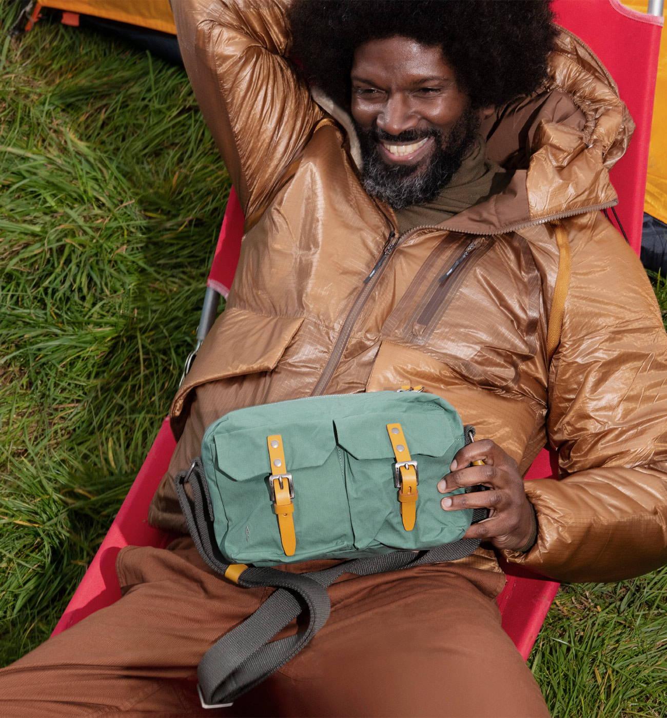 Model wearing the Franco Waxed Cotton Crossbody Bag in Green