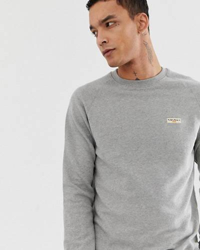 Man wearing grey organic cotton nudie jeans sweatshirt