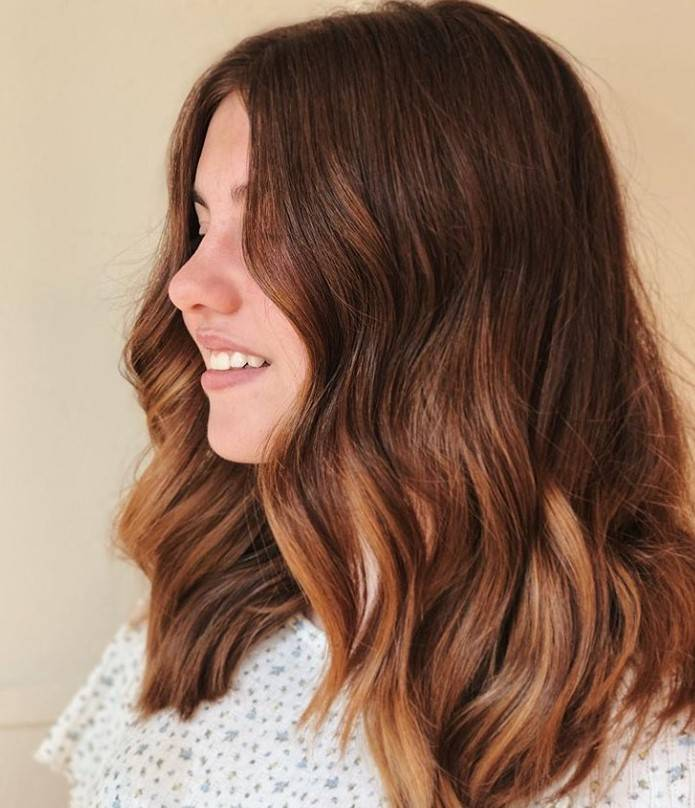 Woman with medium length auburn hair