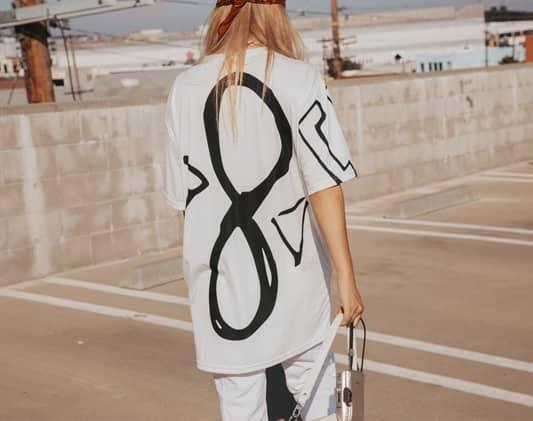 a women is wearing fashion cloth