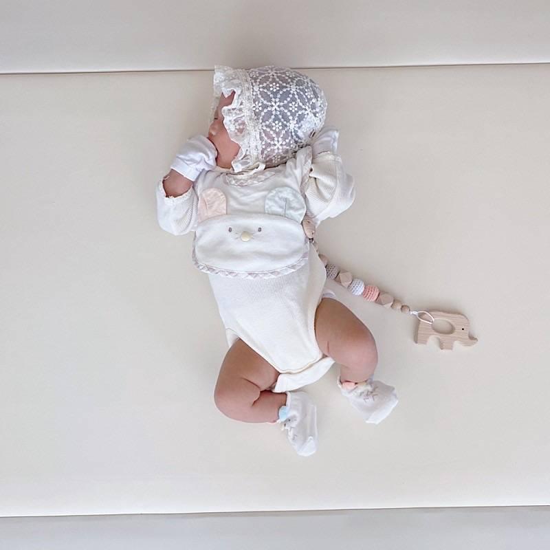 Newborn baby laying on AlZiP mat