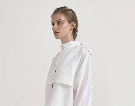 a woman wears a white top