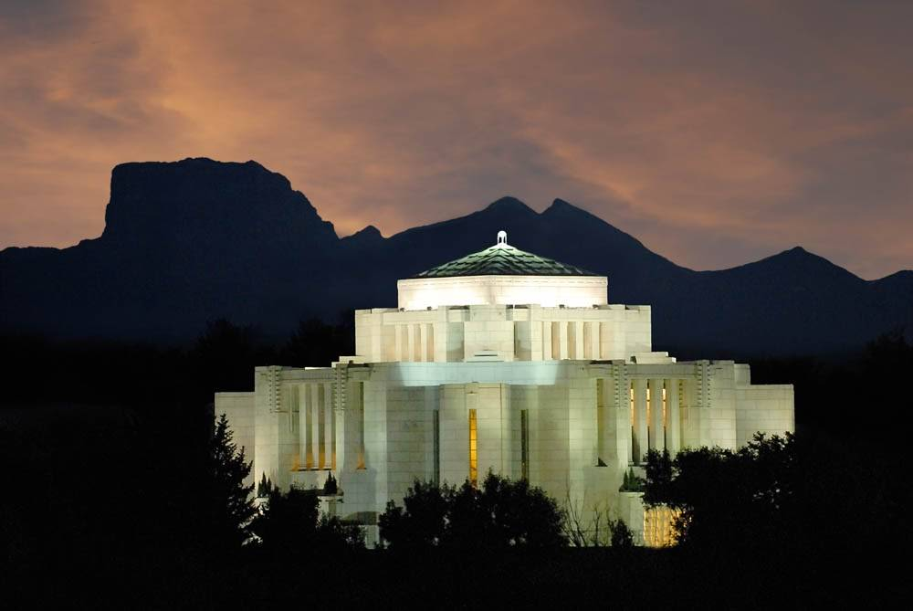 LDS art photo of the Cardston Temple glowing against an evening sky.