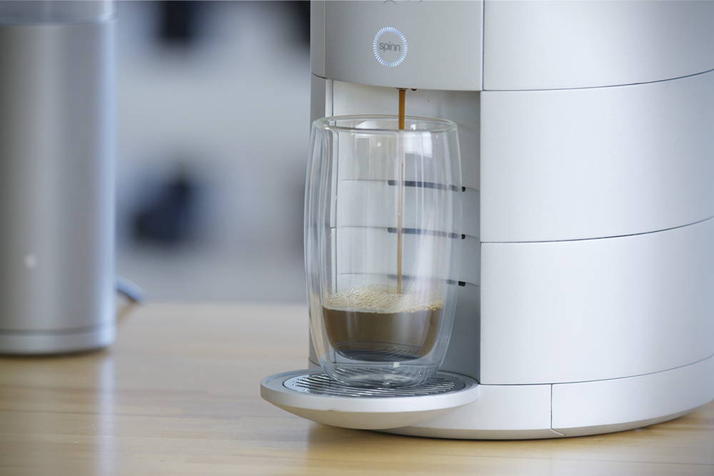 Centrifugal coffee brewer on a kitchen counter