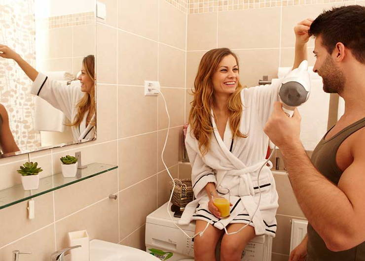 woman helping man style his hair