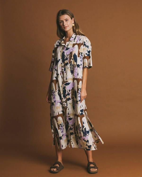 Woman wearing pastel organic cotton belted shirt dress