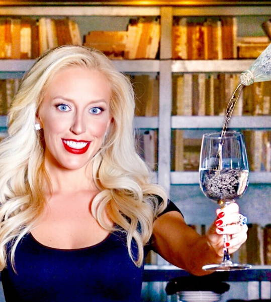 Water and wine sommelier Jessica Altieri holding glass with water being poured in