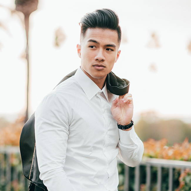front shot of asian model wearing white slim dress shirt with blazer