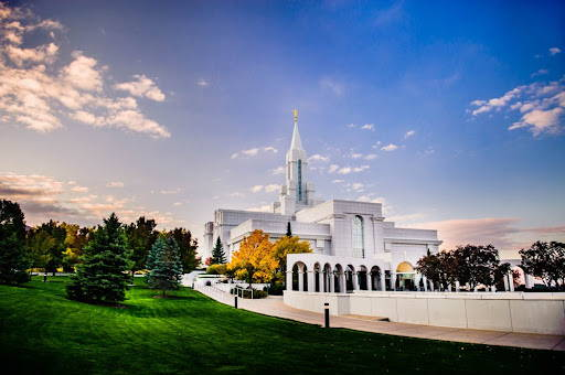 Bountiful temple photo. Autumn trees dot the green grounds.