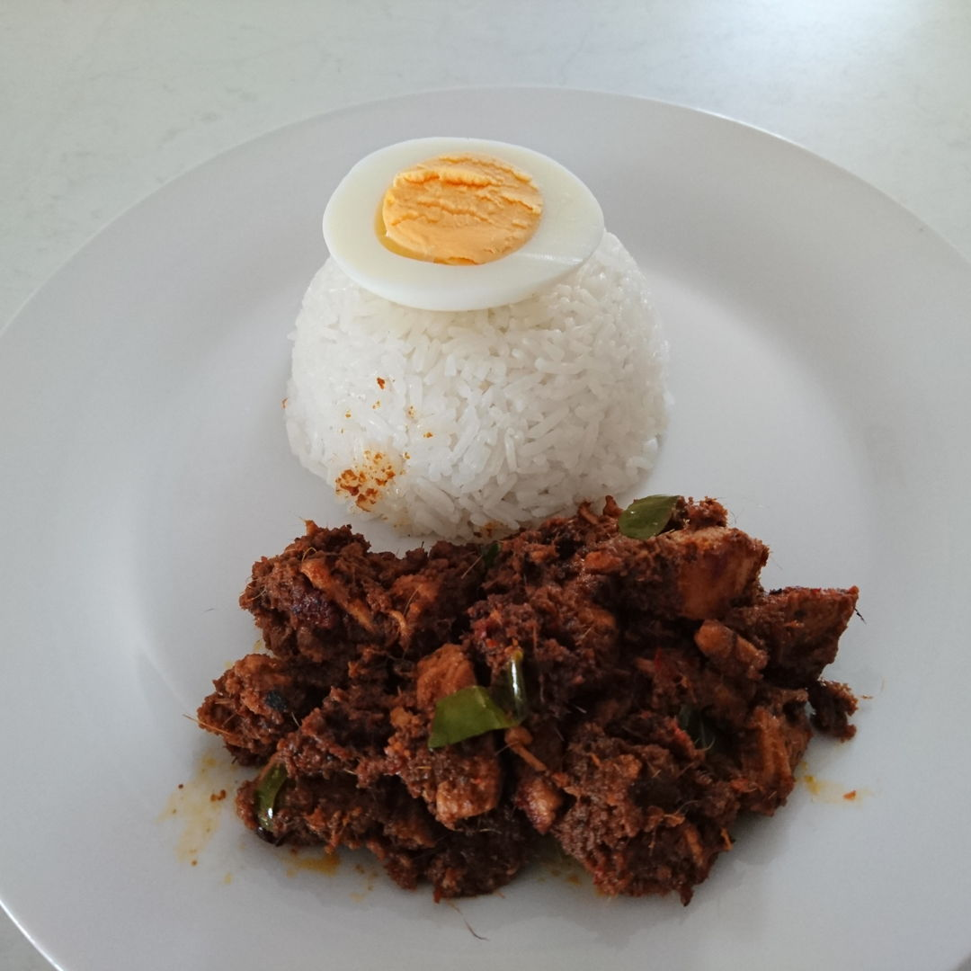 Date: 17 Oct 2019 (Thu) 31st Main: Chicken Rendang (Rendang Ayam) – Rendang Pedas Ayam [71] [Score: 8.3] Author: Nyonya Cooking [Grace Teo]  Photo shows Chicken Rendang served with rice and hard-boiled egg.  Had discussed with Mira on preparing kerisik. She had strongly suggested using frozen grated coconut (as in MasterChef recipe). Kitchen Guardian, however, got to know what I'm up to, i.e. trying to make kerisik from scratch. Guardian said there's no need because there are 3 ready-made packets of kerisik (each 35g) in the pantry, which was bought in Malaysia 4 years ago! Each packet cost 80 Malaysian cents.  Guardian insisted that I use the packet kerisik, and so I did.   Using MasterChef recipe, happy to note that the Chicken Rendang was almost cooked to perfection, but the kerisik smells! Gotten a score of 8.3. Finally, the Guardian agreed to dump the rest of the kerisik packs in the bin. I'm happy :). The next time round I'll prepare kerisik as advice by MasterChef and Mira.