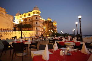 Enjoy a sunset dinner overlooking Udaipur's palaces